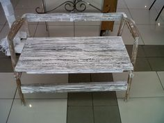 a bench made from discarded pallet wood and a broken chair, the sides thereof.
