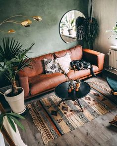 20 Top Design Ideas For A Small Living Room. 20 Top Design Ideas For A Small Living Room. A living room is the most essential part of a household. It depicts the personalities of the people staying in […] Boho Living Room, Interior Design Living Room, Home And Living, Earthy Living Room, Living Room Decor Green, Brown And Green Living Room, Living Room With Plants, Small Living Room Designs, Jungle Living Room Decor