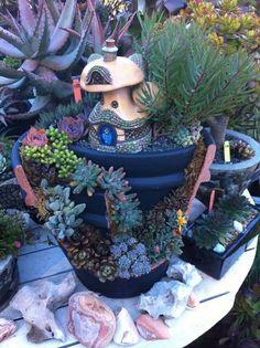 Miniature garden in a broken pot using succulents