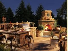 Dream outdoor kitchen/patio. I love how the sitting area/bar stool space is attached to the grill area.