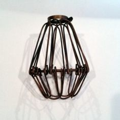 From Our USA retailer:Vintage Style Bulb Cage, Aged Bronze. It is beautiful, isn'it? #vintage #cage #lighting #style #homedecor