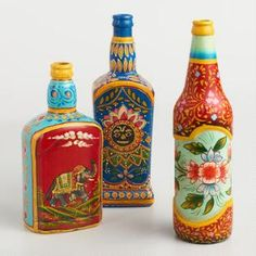 Our bright decor pieces from India are one-of-a-kind recycled glass bottles hand painted with designs inspired by traditional Rajasthani folk art. Recycled Glass Bottles, Glass Bottle Crafts, Painted Wine Bottles, Wine Bottle Art, Diy Bottle, Pottery Painting Designs, Bottle Painting, Diy Canvas Art, Bottle Design