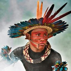 The winning photograph - Asurini do Tocantins man in the Tocantins River, Amazon