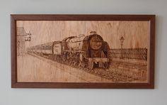 Steam locomotive pulling in to Levisham station, NYMR, Yorkshire.