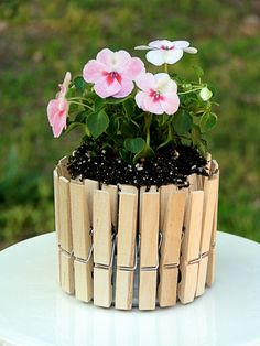 Mini Picket Fence Flower Pots. I didn't use a tuna can, but used a pinapple can and had Travis cut it down. Came out so pretty!