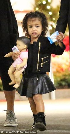 Getting ready? North's doll would be handy practice before her real baby brother arrives next month