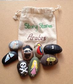 Story Stones help promote literacy, story telling skills bu creating stories using the pictures as stimuli. 8 stones in a cotton pouch. Each stone is approx 2cm and is painted in acrylics and protected with sealant. Pirate Story Stones include: Pirate Parrot Girl Treasure chest Pirate boat Sailing boat Treasure map Skull and cross bones