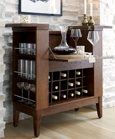There's more than meets the eye in this compact entertainment bar. Parker's drop-down front and two top leaves open to a full-service bar with plenty of room to fix and serve drinks as well as store bottles and supplies.