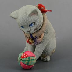 Handcrafted one of a kind cat playing with a ball. Handmade by Ishikawa Kaori. She uses antique and vintage japanese silk fabrics. She studied dollmaking under a prominent artist Matsumoto Katsuko