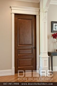Interior doors stained with white trim. Crown moulding?