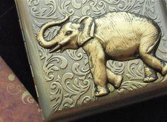 Elephant Cigarette Case Extra Big Antiqued Bronze Gold Metal Wallet Gothic Victorian Steampunk Safari Animal Vintage Inspired. $55.00, via Etsy.