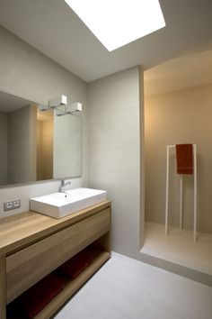 Cozy Mid Century House Plans by Minim: Attractive Bathroom With White Sink And Wooden Vanity Under The Bright Light In The Home And Wine Cel. Minimalist Bathroom, Modern Bathroom, Small Bathroom, Compact Bathroom, Bad Inspiration, Bathroom Inspiration, Bathroom Furniture, Bathroom Interior, Shelf Furniture