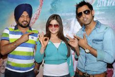 Indian comedian and actor Gurpreet Ghuggi  (L), Bollywood actress Zarine Khan and Punjabi singer and actor Gippy Grewal pose for a photograph during a promotional event for the forthcoming Punjabi film Jatt James Bond