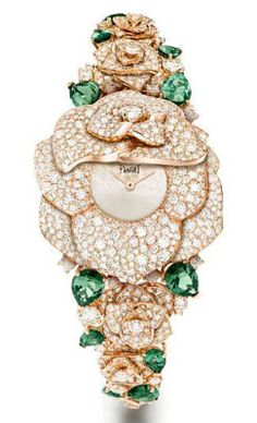 Piaget Mediterranean Garden Watch 18K pink gold. Case set with 668 brilliant-cut diamonds. Silvered dial. Piaget 56P quartz movement. Bracelet set with 12 pear-shaped green tourmalines and 488 brilliant-cut diamonds.