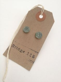 Ceramic stud earrings with olive green glaze by Bridge118Ceramics