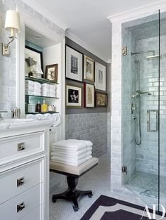 The master bath contains shower fittings and towels by Restoration Hardware | archdigest.com