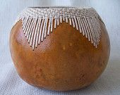 Small gourd bowl with stitched and woven V pattern at rim.  1608