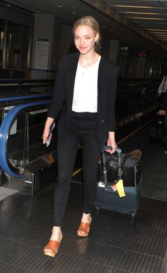 Amanda Seyfried is seen at Narita International airport. Amanda Seyfried visited Tokyo for three days to promote Shiseido's Cle de Peau Beaute moisturizer for the customers in Asian countries.