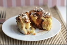 smores sticky bun rolls; dough is a basic sweetened, buttery yeast dough, and it's rolled out and filled with marshmallow cream (one of the finer things in life) and milk chocolate; the rolls are sliced and placed in a bed of graham cracker crumbs and more milk chocolate.