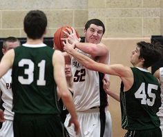 Whitman-Hanson's (52) Mitchell Kenney comes up with the rebound against Duxbury during second-quarter action at Whitman-Hanson on Monday, Jan.18, 2016. (Dave DeMelia/The Enterprise)