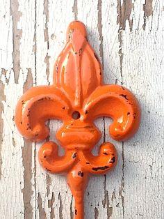 Orange Wall Hook - Cast Iron Retro Vintage Inspired Modern Wall Hook  Rack- Rustic Bicycle Orange. $12.00, via Etsy.