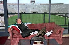 Former Florida State University head football coach Bobby Bowden relaxing  with Charlie Ward's Heisman trophy (ca.1993).   Florida Memory