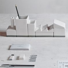 This cute minimalist desktop organizer, called Desktructure, consists of porcelain containers shaped to look like a cityscape.