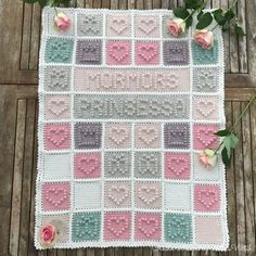 """Bobble stitch baby blanket by BautaWitch. The text says in Swedish """"Grannys Princess""""."""