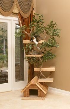 I really want to build my own cat tree, especially after seeing this picture (fake tree house)..My last cat tree cost $$$$$ and now its falling apart after a year or so of use. Anyone else made their own cat condo's/ trees? Would love tips and ideas.
