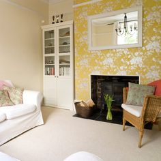 Neutral carpet in living room with sofa, cupboard, feature wall and mirror above fireplace and chair.
