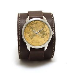 Vintage travel map dial picture watches with genuine leather dark brown belt with wide pad. Gentle contrast stitching, one monolithe buckle, double layers of skin allows long use of accessory. Look nice on the wrist from 15 to 19,5 cm lenght. As usual we install silver color hands in