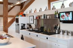commercial-grade modular cooktops with downdraft by GE Monogram & a custom, but inexpensive stainless backsplash - farmhouse kitchen by Adrienne DeRosa