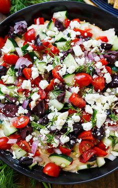 Creamy Greek Dip with cream cheese, hummus, tomatoes, cucumber, olives, feta, and fresh dill