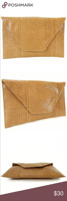 "Python Light Tan Oversized Clutch - Champagne Color: Champagne;  Dimensions:  14-3/4""x 7-1/2""x 1/4"";  oversized Clutch;  python snake embossed; faux leather (shiny nice);  1-interior slip pocket;  zipper and snap closure;  removable shoulder strap;  black interior fabric. Bags Clutches & Wristlets"