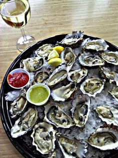 Happy Hour at Westlake Whole Foods - 2 dozen oysters and a glass of wine all for myself #happyhour #wholefoods #oysters #seattle