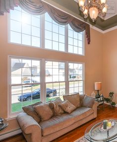 Large new windows we installed in this superb living room with cathedral ceilings  . . . . . . . . . .  Home Remodeling / Home Improvement / Renovation / Replacement Windows from Renewal by Andersen Long Island