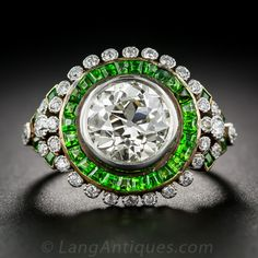 An extraordinary and extraordinarily beautiful ring featuring a carat European-cut diamond encircled by vivid, electric lime-green demantoid garnets from the Ural mountains, which, in turn, are encircled with tiny bezel-set old-mine cut diamonds. Garnet Jewelry, Diamond Jewelry, Diamond Rings, Art Deco Jewelry, Bling Jewelry, Jewellery, Pearl Jewelry, Jewelry Rings, Bling Bling