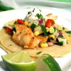 Fiery Fish Tacos with Crunchy Corn Salsa Recipe - Spicy grilled fish are cooled down with a fresh crunchy veggie salsa featuring fresh corn. Your guests will swim back for seconds! Fish Recipes, Seafood Recipes, Mexican Food Recipes, Great Recipes, Cooking Recipes, Favorite Recipes, Healthy Recipes, Cooking Fish, Recipies
