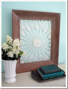 LG doily in a wooden frame..lucky me..I need to do this with the few doilies that we have left from my aunt Dot.  great keepsake