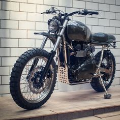 Here's an exclusive look at the custom Scrambler that will headline the Triumph Tridays festival in Europe. It's the work of Dirk Oehlerking of Kingston Custom, and designed to evoke the glory days of Steve McQueen and the ISDT. We're sold — are you?