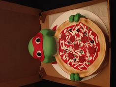 Teenage Mutant Ninja Turtle Cake!  Chocolate cake covered with marshmallow fondant. By Amy Hart