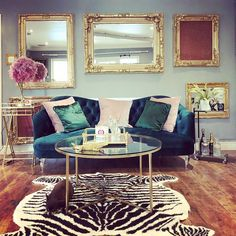 House tour- opulent and eccentric décor. Glam, gold living room with velvet sofa and zebra rug. Silver Living Room, Teal Living Rooms, Living Room Turquoise, Living Room Sofa, Rugs In Living Room, Living Room Designs, Blue Velvet Sofa Living Room, Teal Velvet Sofa, Silver Bedroom