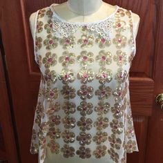 SPRING FEVER! Sequin Daisy Lace Collar Top NWT S New with tags Beautiful sleeveless top with lace collar and sequin daisies all over! Buttons up the back make this top special for spring!!! Size small Joyce Leslie Tops Blouses