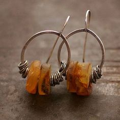 Earrings, handmade of oxidized sterling silver (925/999) and raw ambers. Diameter of the wheels - 3 cm or 1.2 inches  natural amber - +/- 1.8 cm or 0.72