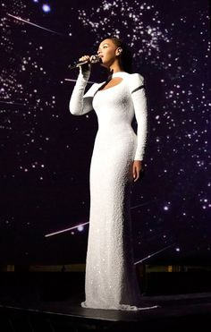 """Beyonce looked literally out of this world during a performance of """"I Was Here,"""" which she gave at the United Nations in honor of World Humanitarian Day. Wearing a sparkling white floor-length Marc Bouwer gown, Bey oozed elegance. (8/10/2012)"""