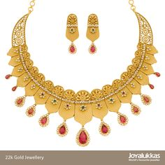 This limited edition jewellery set features a traditional design, reminiscent of the royal era. Exquisitely crafted in 22k gold and studded with colored Zirconia stones, this stunning necklace with matching earrings will make you feel like a queen.  Approx. weight : 89 grams