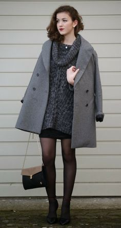 Shop this look for $183:  http://lookastic.com/women/looks/overcoat-and-cowl-neck-sweater-and-heels-and-crossbody-bag-and-mini-skirt/1948  — Grey Overcoat  — Charcoal Cowl-neck Sweater  — Black Leather Heels  — Black Leather Crossbody Bag  — Black Mini Skirt