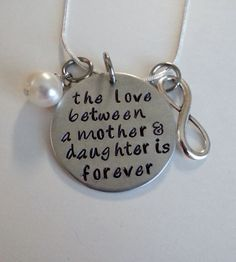 the love between a mother and daughter is forever hand stamped necklace by TempleStamping