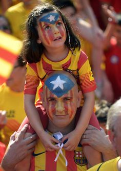 A girl with her face painted with the flag that symbolizes Catalonia's independence joins a demonstration in Barcelona, Spain, on Sept 11.