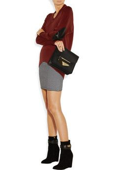 Maison Martin Margiela                                  Leather-embellished fine-knit wool sweater  Shown here with: Maiyet ring, Maison Martin Margiela rings, Theory skirt, Givenchy shoes, Sophie Hulme bag.                             $695